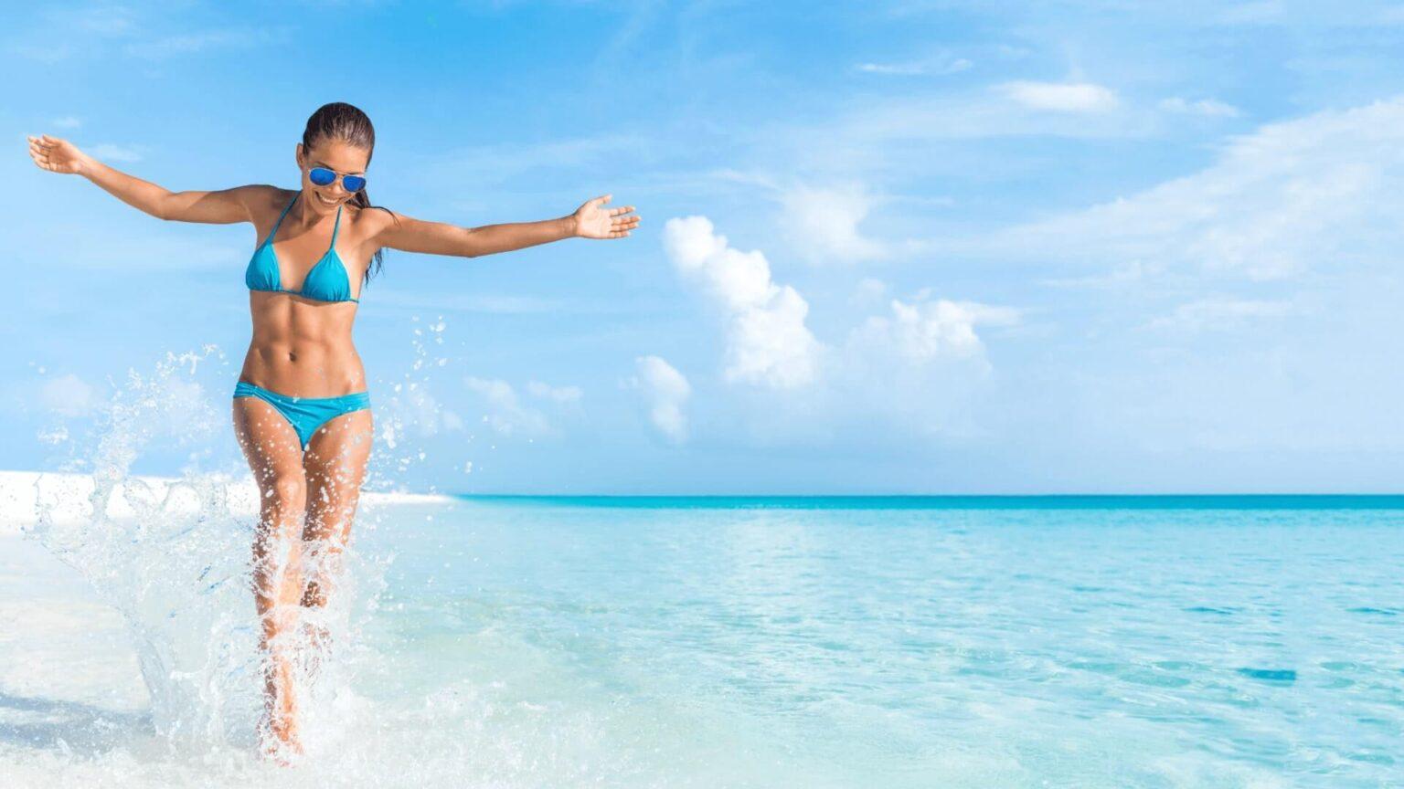 Sexy woman wearing swimsuit in the ocean